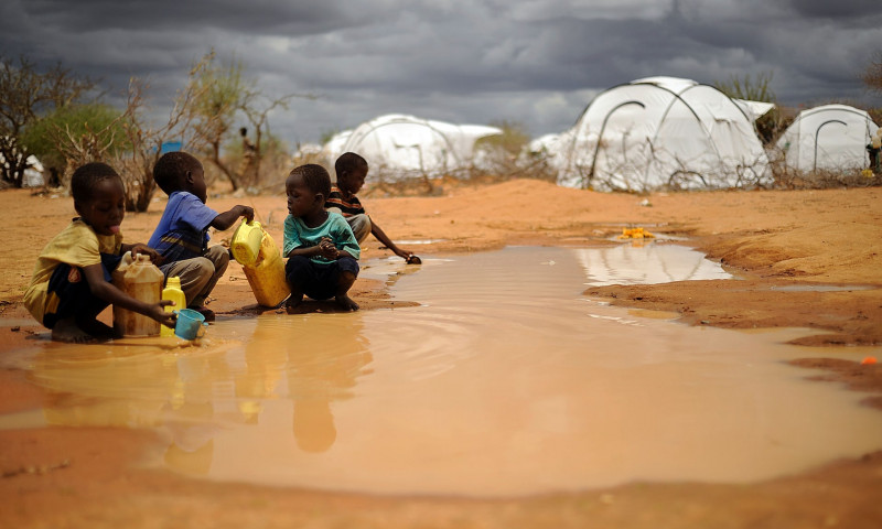 Somali boys collect water from a puddle at the sprawling Dadaab refugee complex in Kenya. Photograph: Tony Karumba/AFP/Getty